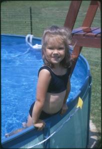 Me enjoying our backyard pool on a warm NJ day